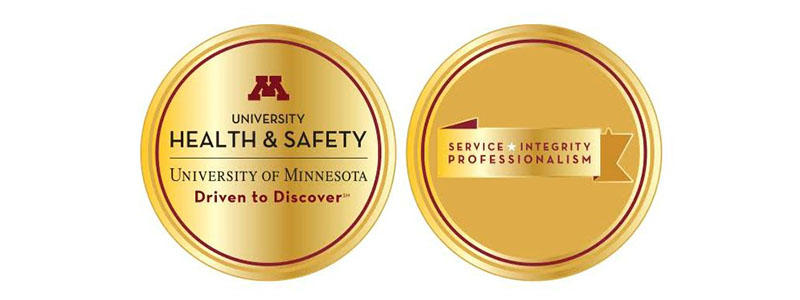 UHS Challenge Coins Showing UHS Graphic Element and Values: Service, Integrity, and Professionalism